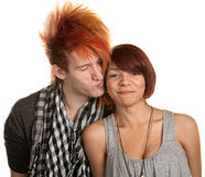 Young Man Kissing Girlfriend. Young men with mohawk kisses mixed girlfriend over white Royalty Free Stock Photo