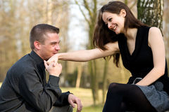 Young man kissing her hand Royalty Free Stock Image