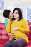 Young man kissing his expectant wife Royalty Free Stock Image