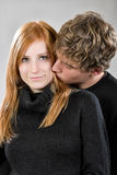 Young man kissing his girlfriend Stock Image
