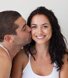 Young man kissing his girlfriend. At home Stock Images