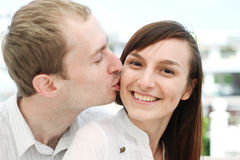 young man kissing his girlfriend Stock Photos