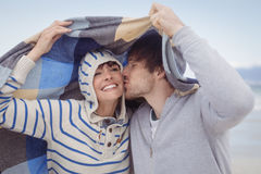Young man kissing his girlfriend during winter Royalty Free Stock Photos