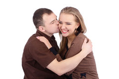 Young man kissing his smiling girlfriend Stock Image