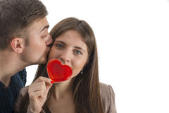 Young man kissing his wife isolated Stock Images