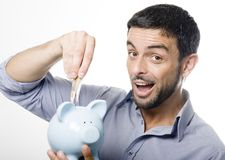 Young Man kissing Piggy bank Stock Images
