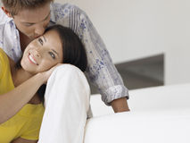 Young Man Kissing Smiling Woman Stock Photo