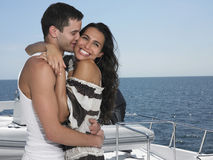 Young Man Kissing Woman On Yacht Royalty Free Stock Photography
