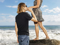 Young Man Kissing Womans Hand stock images