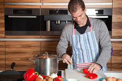 Young man in the kitchen Royalty Free Stock Image