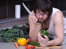 Young man in the kitchen Stock Images