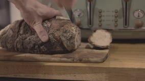Men cutting bread stock video