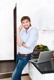 Young man kitchen Stock Image