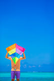 Young man with a kite on a background of turquoise Royalty Free Stock Photos