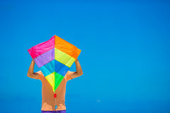 Young man with a kite on a background of turquoise Stock Photos