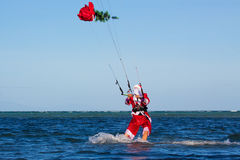 Young man on the kite in the costume of Santa Claus with a Chris Stock Photos