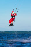 Young man on the kite in the costume of Santa Claus. Christmas a Stock Photography