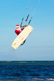 Young man on the kite in the costume of Santa Claus. Christmas a Stock Image