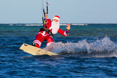 Young man on the kite in the costume of Santa Claus. Christmas a Royalty Free Stock Photos