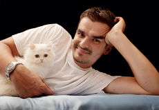 Young man and kitten Stock Photography