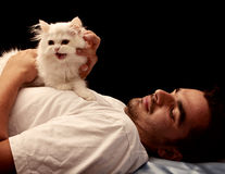 Young man and kitten Stock Photo