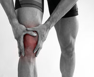 Young man with knee pain Royalty Free Stock Photo