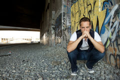 Young Man Kneeling Stock Photo