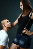 Young man kneels before his girlfriend Royalty Free Stock Photography
