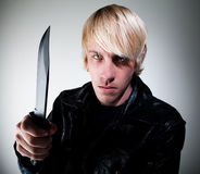 Young man with knife Stock Photography