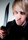 Young man with knife Royalty Free Stock Photo