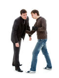 A young man knocks out a businessman. Royalty Free Stock Photo
