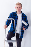Young man on ladder Stock Photography