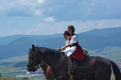 Young man and lady on horseback royalty free stock photography