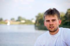 Young man on lake royalty free stock image