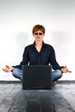 Young man with a laptop Royalty Free Stock Images