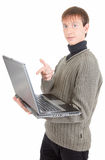 Young man with laptop. Young man  handing  laptop on white background Stock Photography