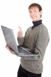 Young man with laptop. Young man  handing  laptop on white background Royalty Free Stock Photos
