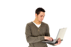 Young man with laptop. Half body portrait of young man with laptop computer, isolated on white background Royalty Free Stock Images