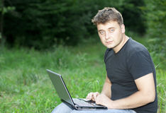The young man laptop Royalty Free Stock Photos