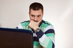 Young man and laptop Royalty Free Stock Photo