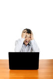 Young Man With Laptop. Shocked Teenager with Laptop on the Desk. Isolated on the White Background Stock Images