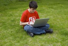Young man and laptop. Human hand pressing a key on a laptopkeyboard Stock Photo