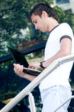 Young man with laptop Royalty Free Stock Images