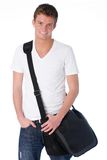 Young man with laptop bag Stock Images