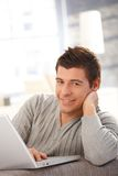 Young man with laptop computer Royalty Free Stock Photo