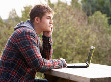 Young man with laptop computer Stock Photo