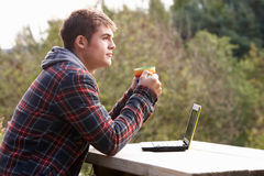 Young man with laptop computer Stock Photos