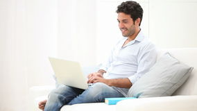 Young man at laptop stock footage