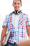 Young man with laptop and headphones Royalty Free Stock Image