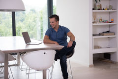 Young man with laptop at home Royalty Free Stock Photography